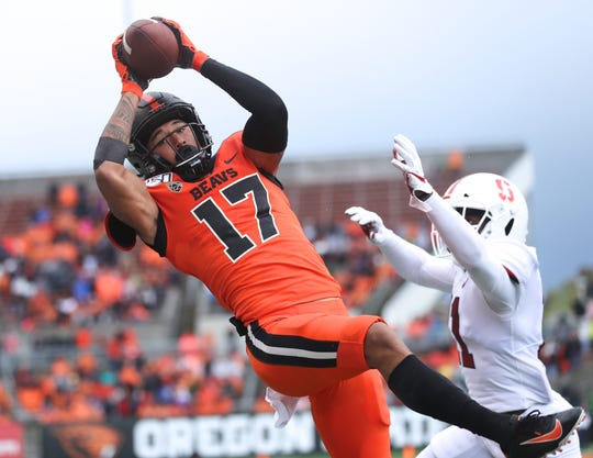 Sep 28, 2019; Corvallis, OR, USA;  Oregon State Beavers wide receiver Isaiah Hodgins (17) makes a reception over Stanford Cardinal cornerback Paulson Adebo (11) in the first half at Reser Stadium. Mandatory Credit: Jaime Valdez-USA TODAY Sports