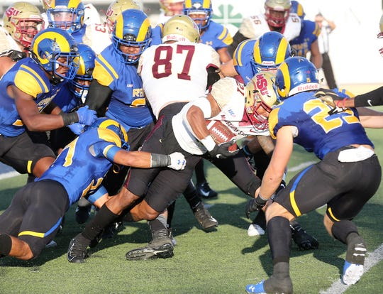 Midwestern State University's Quinton Childs is swarmed by the Angelo State University defense during a Lone Star Conference game at LeGrand Stadium at 1st Community Credit Union Field Saturday, Sept. 28, 2019.