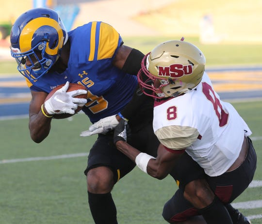 Angelo State University's Keke Chism makes a reception as Midwestern State's Jaydon Cunigan defends during a Lone Star Conference game at LeGrand Stadium at 1st Community Union Field Saturday, Sept. 28, 2019.