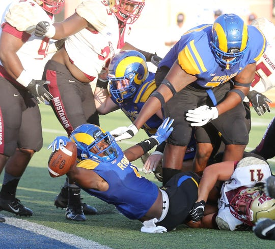 Angelo State University's Lloyd Howard comes just short of scoring a touchdown against Midwestern State during a Lone Star Conference game at LeGrand Stadium at 1st Community Credit Union Field Saturday, Sept. 28, 2019.