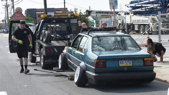 A tow truck gets ready to tow a VW after a camber violation at the unofficial H2Oi event in Ocean City Sunday, September 29, 2019. According to police the owner faces about a $420 fine and a $350 tow bill.
