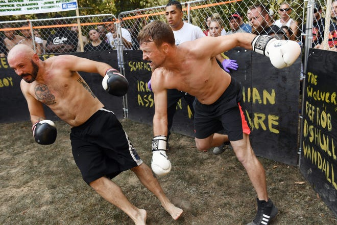 Charles Surber, left, and Jeff Spille, fight during a Streetbeefs event in Winchester, Va. The fight club's founder started the group to combat violence on the streets.