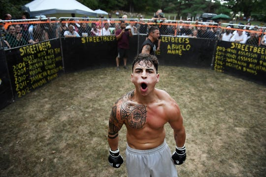 "Anthony ""Italian Tyson"" Russo of Frederick, Md., celebrates after a mixed martial arts match at Streetbeefs."