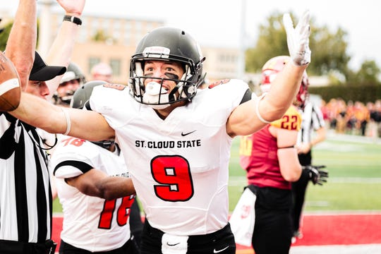 SCSU wide receiver John Solberg celebrates his touchdown in the second quarter versus Northern State on Sept. 28.
