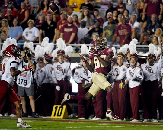 Sep 28, 2019; Tallahassee, FL, USA; Florida State Seminoles wide receiver Ontaria Wilson (80) catches a touchdown pass during the first half against the North Carolina State Wolfpack at Doak Campbell Stadium. Mandatory Credit: Melina Myers-USA TODAY Sports