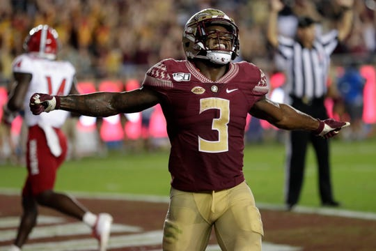 Florida State Seminoles running back Cam Akers (3) celebrates a touchdown. The Florida State Seminoles beat the North Carolina Wolfpack 31-13 Saturday, Sept. 28, 2019.