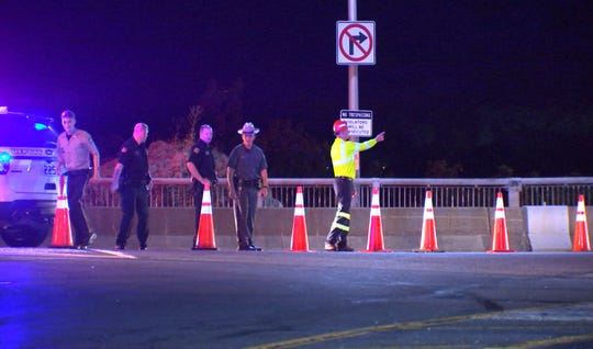 Police pictured blocking off Bear Mountain Bridge Road on the Westchester side of the bridge late Saturday.