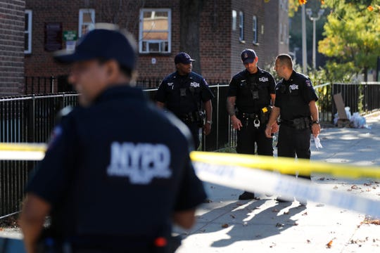 Emergency personnel work near the scene of a fatal shooting of a police officer in the Bronx borough of New York, Sunday, Sept. 29, 2019.  (AP Photo/Seth Wenig)