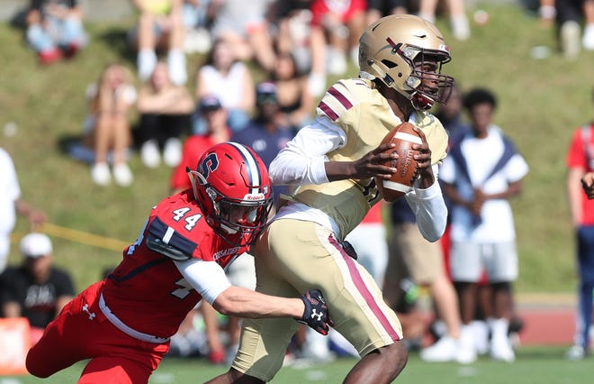Iona's Darius Wilson (11) breaks away from Stepinac's Brendan Wilkins (44)  during action at Stepinac High School in White Plains Sept. 28, 2019.  Iona won the game 36-35.