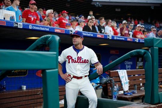 Philadelphia Phillies manager Gabe Kapler waits to greet bullpen players after a baseball game against the Miami Marlins, Sunday, Sept. 29, 2019, in Philadelphia.