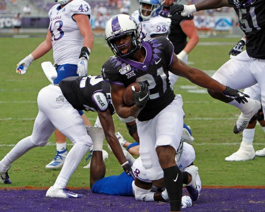 TCU Horned Frogs running back Daimarqua Foster (21) scores in the fourth quarter as the Kansas Jayhawks play the TCU Horned Frogs at Amon Carter Stadium in Fort Worth, Texas Saturday, Sept. 28, 2019. TCU won 51-14.  (David Kent/Star-Telegram via AP)