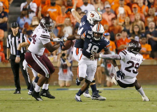 Auburn Tigers receiver Seth Williams gets past Mississippi State Bulldogs safety C.J. Morgan during the second quarter at Jordan-Hare Stadium.