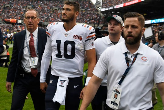 Bears quarterback Mitchell Trubisky (10) leaves the field after injuring his shoulder against the Vikings during the first quarter at Soldier Field.