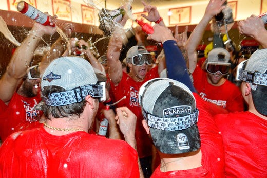 September 29: Cardinals players celebrate their NL Central title win with a 9-0 win over Cubs.