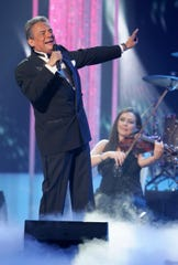 In this April 28, 2011 file photo, Jose Jose performs during the Latin Billboard Awards, in Coral Gables, Fla. Local media outlets report that the Mexican crooner died Saturday, Sept. 28, 2019 from pancreatic cancer. He was 71.