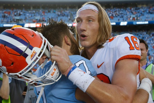 North Carolina Tar Heels quarterback Sam Howell embraces Clemson Tigers quarterback Trevor Lawrence after the game at Kenan Memorial Stadium.
