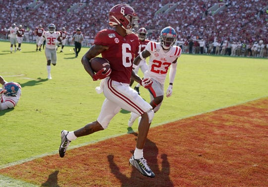 Alabama wide receiver DeVonta Smith  scores one of his five touchdowns against Mississippi.