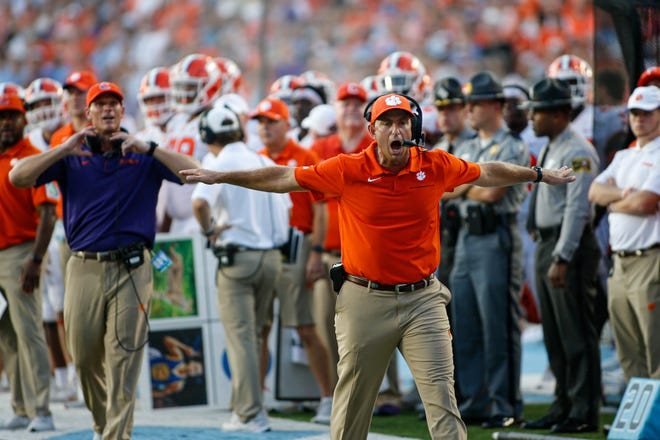Clemson head coach Dabo Swinney argues for an incomplete pass during the Tigers' narrow win over North Carolina.