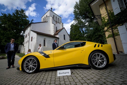 A picture taken on September 28, 2019 at the Bonmont Abbey in Cheserex, western Switzerland shows a 2015 Ferrari F12tdf model car during an auction preview by sales house Bonhams of sport cars belonging to the son of the Equatorial Guinea's President.