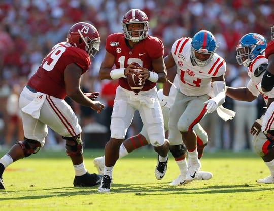 Alabama quarterback Tua Tagovailoa escapes the pocket as he looks to pass against Mississippi.