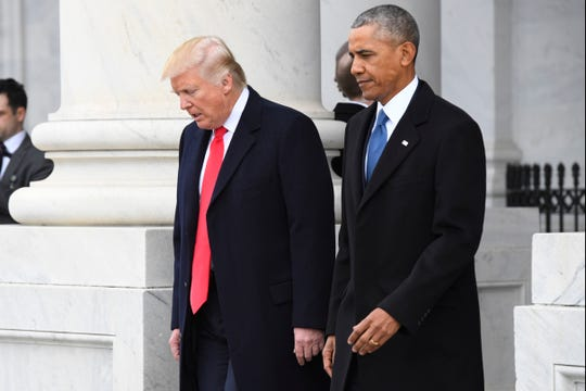 President Donald Trump and former President Barack Obama attend the inauguration on Jan. 20, 2017.