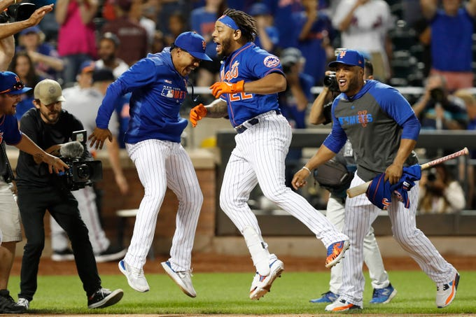 Sept. 29: Mets players celebrate Dominic Smith's walk-off three-run homer in the 11th inning against the Braves.