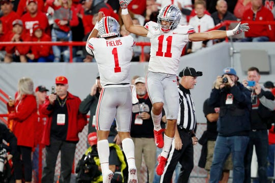 Ohio State Buckeyes wide receiver Austin Mack celebrates with quarterback Justin Fields after scoring against the Nebraska Cornhuskers in the first half at Memorial Stadium.