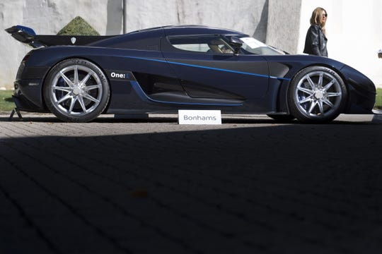 A 2015 Koenigsegg One:1 model car, part of some 25 luxury cars owned by Teodoro Obiang, the son of the Equatorial Guinea's President Teodoro Obiang Nguema Mbasogo before an auction of sales house Bonhams at the Bonmont Abbey Golf & Country Club in Cheserex near Geneva, Switzerland, 29 September 2019.