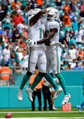 DeVante Parker (left) celebrates after his touchdown.
