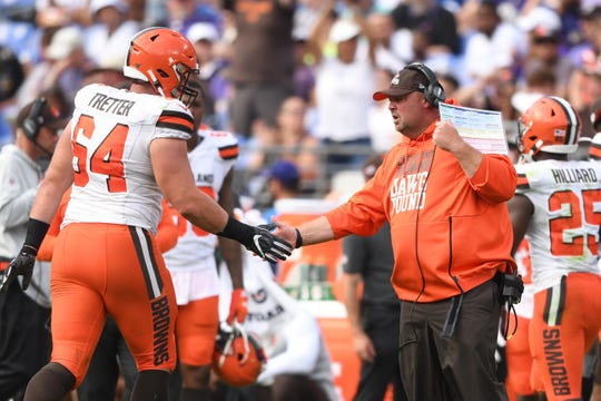 Cleveland Browns head coach Freddie Kitchens congratulates Cleveland Browns center JC Tretter (64) on a play in the first quarter in a football game against the Baltimore Ravens at M&T Bank Stadium.