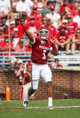 Sep 28, 2019; Norman, OK, USA;  Oklahoma Sooners quarterback Jalen Hurts (1) throws a touchdown pass during the second half against the Texas Tech Red Raiders at Gaylord Family - Oklahoma Memorial Stadium.