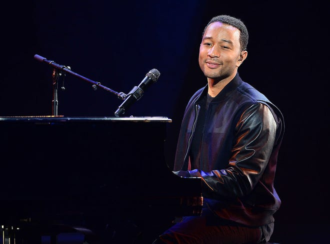 """Chrissy Teigen posted a sweet video of John Legend and son Miles together at the piano. Legend sings and plays """"My Favorite Things"""" while Miles improvises on the side."""