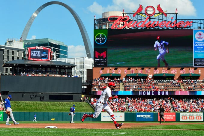 Sept. 29: Cardinals outfielder Dexter Fowler runs the bases after hitting a home run in the second inning against the Cubs.
