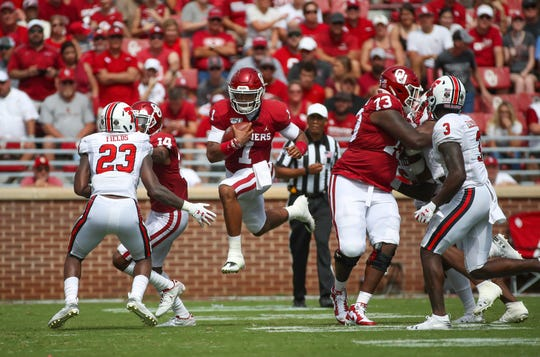 Oklahoma quarterback Jalen Hurts leaps during a run in the second half against Texas Tech at Gaylord Family - Oklahoma Memorial Stadium.