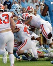 North Carolina's Sam Howell gets stopped on a two-point conversion by Clemson's James Skalski (47) and Xavier Thomas during the fourth quarter.