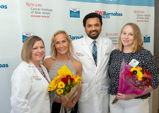 (from left) Bone marrow transplant coordinator Mary Kate McGrath, transplant recipient Leal McGrath, hematologist/oncologist Dr. Vimal Patel, and bone marrow donor Wiebke Rudolph at a special celebration with members of the Blood and Marrow Transplant team at Rutgers Cancer Institute of New Jersey and Robert Wood Johnson University Hospital, New Brunswick.