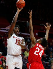 Rutgers Scarlet Knights forward Shaq Carter (13) shoots over Ohio State Buckeyes forward Andre Wesson (24) at the RAC in 2019.