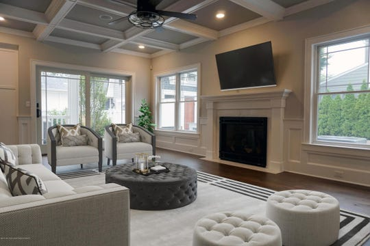 The Living room offers coffered ceilings and a set of custom french doors.