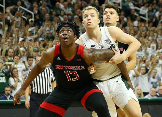 Rutgers Scarlet Knights forward Shaq Carter (13) and Michigan State Spartans forward Thomas Kithier (15) fight for position in 2019.