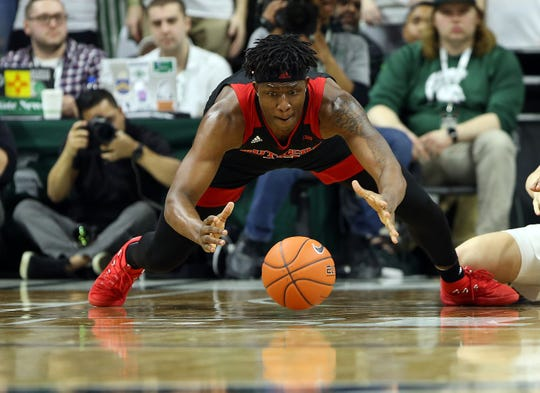 Rutgers Scarlet Knights forward Shaq Carter (13) dives for a loose ball during the second half of a game at Michigan State in 2019.