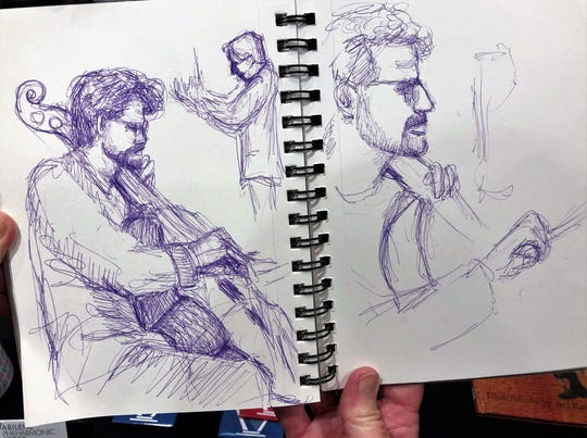 """Photos and video were not allowed Saturday at the Abilene Philharmonic Orchestra concert, but nothing was said about drawing. Abilene artist Kathie Walker-Millar drew guest performer Amit Peled playing his cello next to conductor David Itkin. She said the hardest part was depicting his hands because """"they never stopped moving."""" Sept. 28 2019"""