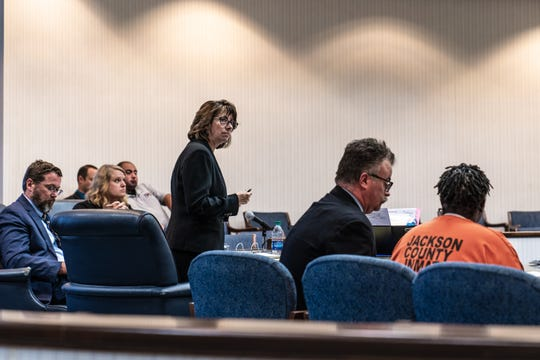 Assistant District Attorney Chris Matheson, standing, and to her right, Asheville lawyer Joe Bowman and defendant Aja Makalo, who is charged with first-degree murder.