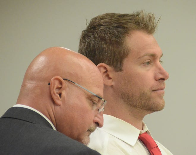Paul Sinclair, right, with his attorney, Robert Hackett in September 2018.