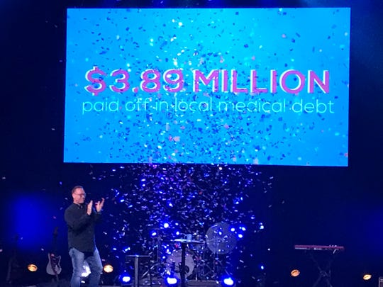 Pastor James Sunnock announces the $3.89 million in medical debt that has been forgiven locally thanks to a fundraising campaign by his congregation, Victory Life Church in Battle Creek, on Sunday, Sept. 29, 2019.