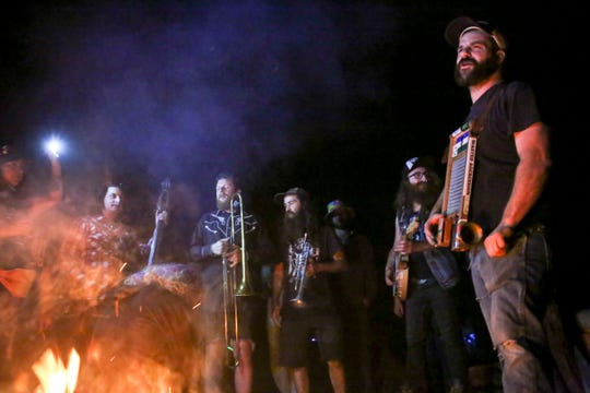 The Truck Bed Boys and a few friends on brass play by the fire during a music festival of Pacific Northwest folk and punk bands on Sept. 1.