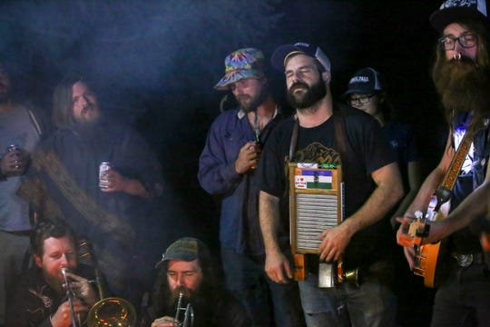 Chris Downey plays washboard and Jeremy Hopkins strums the banjo during a Truck Bed Boys performance at Punx in the Woods on Sept. 1.