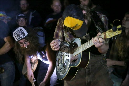 Jeremy Hopkins (left) and Matt McBee (right) play with no amps or lights during Punx in the Woods, a festival for Pacific Northwest punk and folk artists on Sept. 1.