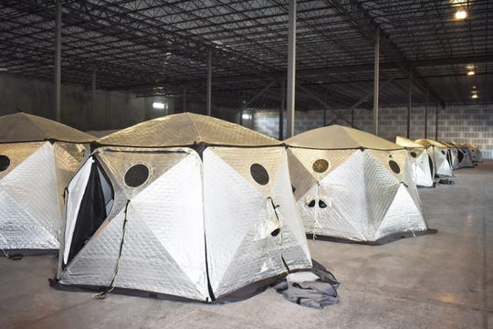 These ShiftPod temporary housing units are being stored at the Port Canaveral Logistics Center in Titusville, awaiting shipment to the Bahamas.