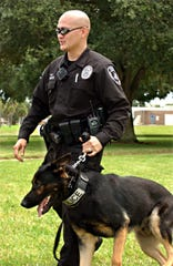 Cocoa police K-9 Timber and Officer Brian Delos-Santos on patrol in August 2008 when U.S. Sen. John McCain spoke at Brevard Community College-Cocoa.