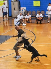 Cocoa police K-9 Timber and Sgt. Tony Marchica perform a demonstration during a 2012 Brevard County Sheriff's Office charity celebrity basketball game.